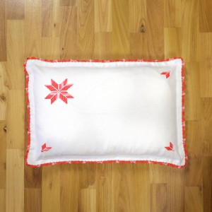 Handsewed pillow case, red motifs