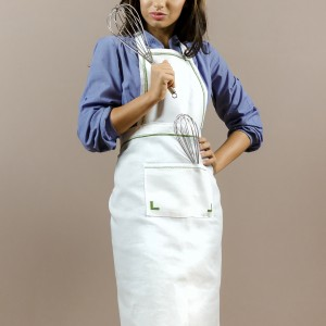 Embroidered apron, green motifs